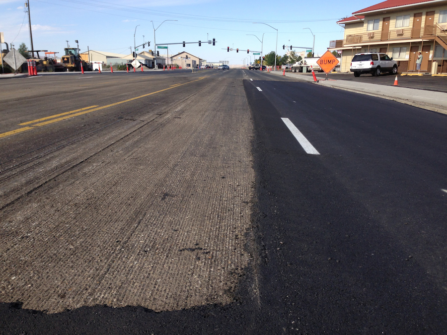 the difference between asphalt overlay and replacement