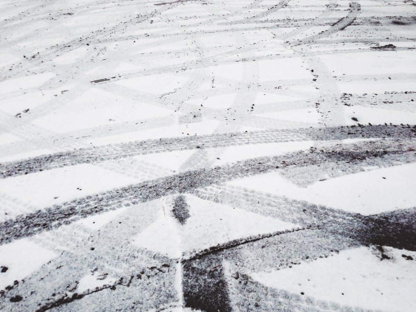 tire tracks in icy parking lot